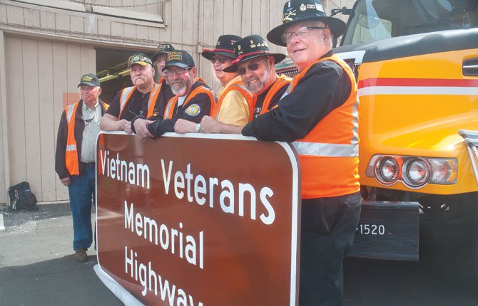 THE DALLES Mayor Steve Lawrence, right, a decorated Army veteran from Vietnam, is shown with one of the 15 signs that will grace Interstate 84, which has been named the Vietnam Veterans Memorial Highway from Interstate 205 to the Idaho border.  Standing with Lawrence, from right, are: Mike Carter, who served in the Army; Terry Low, also Army; Lyle Hicks, Navy; J.W. Terry, Navy; Ron Morgan, president of the Oregon Council of Vietnam Veterans of America; Al Jones, Army; and, Dick Tobiason, co-chair of the Vietnam Veterans Memorial Highway Committee. A dedication for the signs will take place at Monday's Memorial Day ceremony in The Dalles.