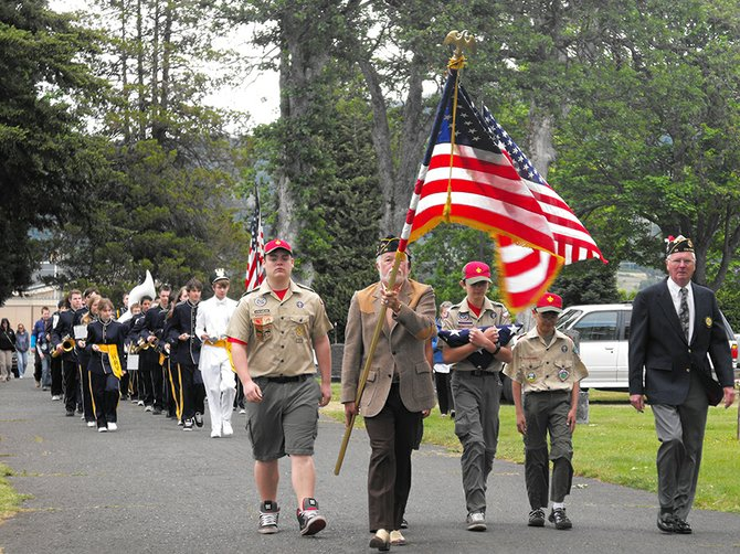 Solemn and patriotic music by the HRVHS band and singer Andy Streich are two highlights of Monday's ceremony at Idlewilde Cemetery on the Heights in Hood River, the only formal Memorial Day observance in the county.