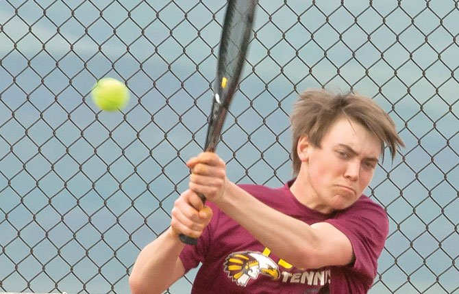 THE DALLES tennis player Griffin Martin fires back a hard return shot in singles action this season. At Hermiston, Martin and the Tribe won a handful of matches, but could not get any state qualifications.                                    TDC File photo