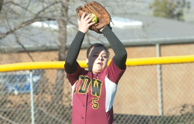 THE DALLES outfielder Hannah Harris corrals a flyball in 5A action this year. Harris and the Eagle Indians kick off state action Friday in Silverton.                         TDC File photo