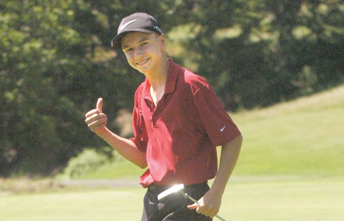 THE DALLES golfer Chase Snodgrass gives a thumbs up while mid-round at the district tournament last week. In two days at Quail Valley Golf Course, Snodgrass, a freshman, racked up a combined 173. TDC File photo