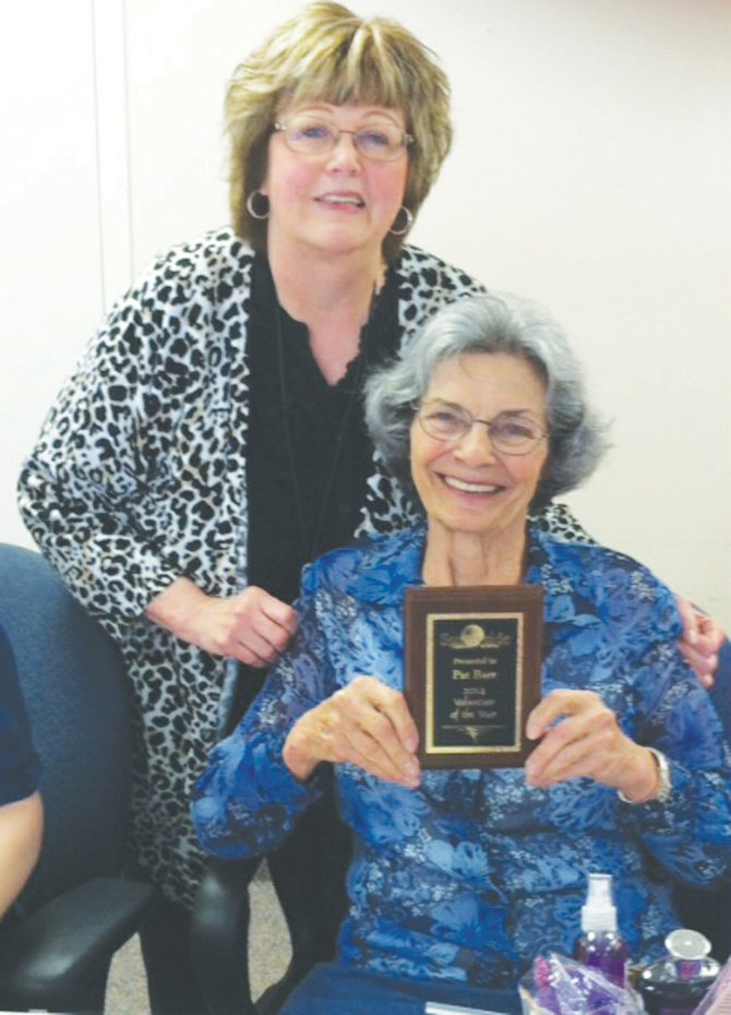 "The Sunnyside Community Hospital Auxiliary chose Pat Barr (seated) as the auxiliary's volunteer of the year. Barr volunteers many hours in the hospital gift shop and ""…her work is greatly appreciated,"" said Charlene Maling, the gift shop manager (standing). Barr was honored last month during the auxiliary's annual volunteer luncheon held at the hospital."