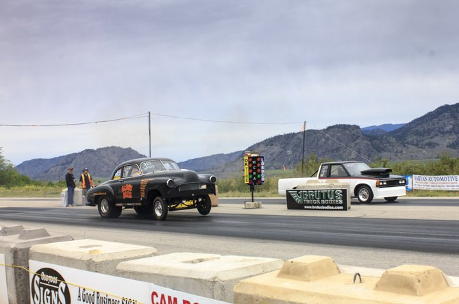 "Ernie Bartleson of Oroville, left, launches his ""Glory Daze"" 1951 Chevrolet at the start of a race Sunday at the Wine Country Racing Association's day of races at the Richter Pass Motorplex outside of Osoyoos, B.C."