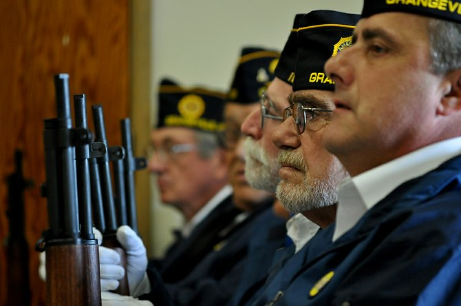 Members of the American Legion Post 37 rifle squad await their honor duties at Monday's Memorial Day ceremony at Grangeville High School.