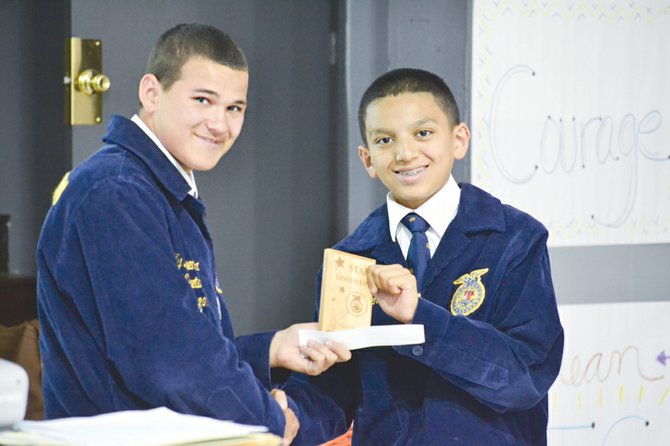 David Jimenez (L) is presented the Star Discovery award by Mabton FFA Vice President Ty Leyendekker. Jimenez received the honor for efforts that included serving as a junior high FFA delegate at the State convention.