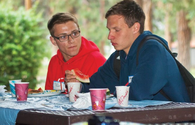 Liam Brewer of The Dalles, left, and Denis Kazakov of Russia enjoy potluck at the AFS farewell picnic at Sorosis Park Wednesday evening, May 28. Kazakov is in the United States as part of a Rotary Club program.