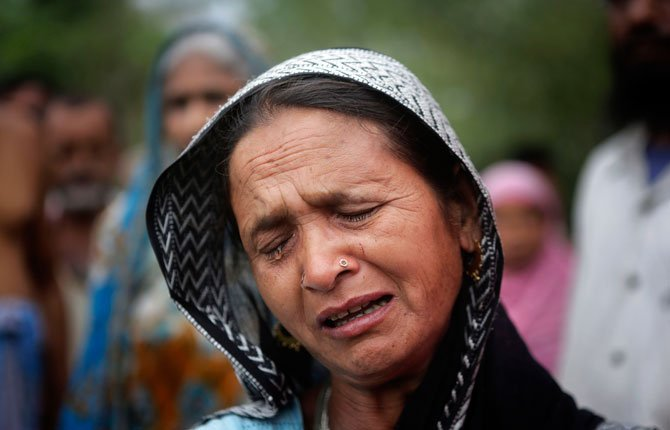 A woman cries near the body of a relative, killed in ethnic violence, at a cremation ground at Narayanguri village, in the northeastern Indian state of Assam, Saturday, May 3. Rampant violence and sexual assault, particularly against the poor and disenfranchised populations of Indian society, are currently two of the most hotly debated issues in the country.