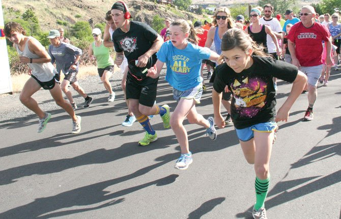 RUNNING enthusiasts burst out of the blocks for the start of last weekend's Riverfest walk/run in Maupin. More than 110 particpants signed on with good intentions to take part in this fundraiser rally.