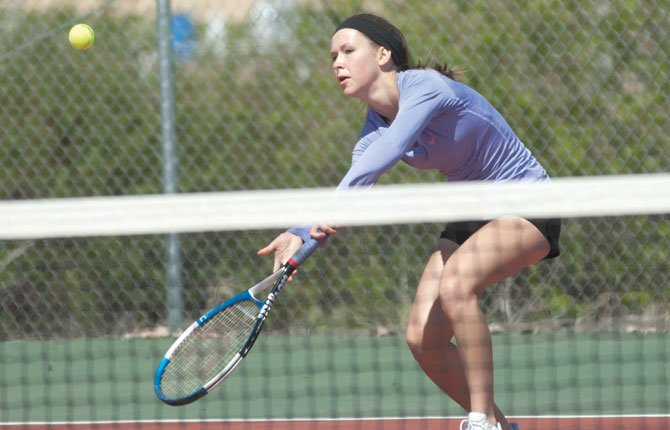 SHERMAN tennis player Meghan Belshe hits a return volley in No. 1 singles action versus Condon in Moro earlier this season. Belshe earned a state berth and will headline a solid returning group for the 2014 campaign.