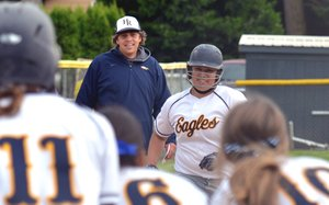Brianna Weekly is all smiles as she passes coach Eric Keller and heads towards home plae, with teammates Jessie Karr, Erika Enriquez and Kelsey Wells waiting to congratulate her for a third-inning, three-run homer that sealed the Eagles' 8-0 playoff win Tuesday.