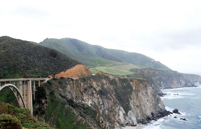 THE BIG SUR coastline, with its ridges and ravines, was largely inaccessible until construction of U.S. Highway 101 opened it to motorists.