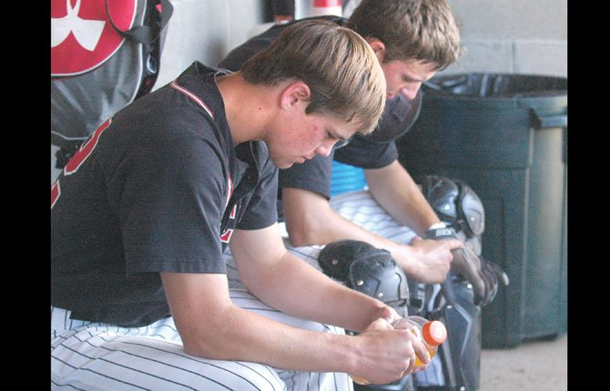 DUFUR  baseball players Trever Tibbets (left) and Jake Kortge ponder bits and pieces of what happened in Friday's 16-9 loss to Monroe. The Rangers fell behind 10-1 in the third inning and tried to rally, but fell short late.