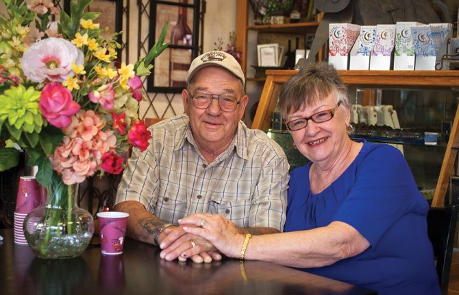 Hank and Linda Brown take a short break at Sigman's Flowers in downtown The Dalles, where they pick up flowers the florist donates each week to hospice. They deliver the flowers to two local care centers, where residents create bouquets from them that are then given to hospice patients.