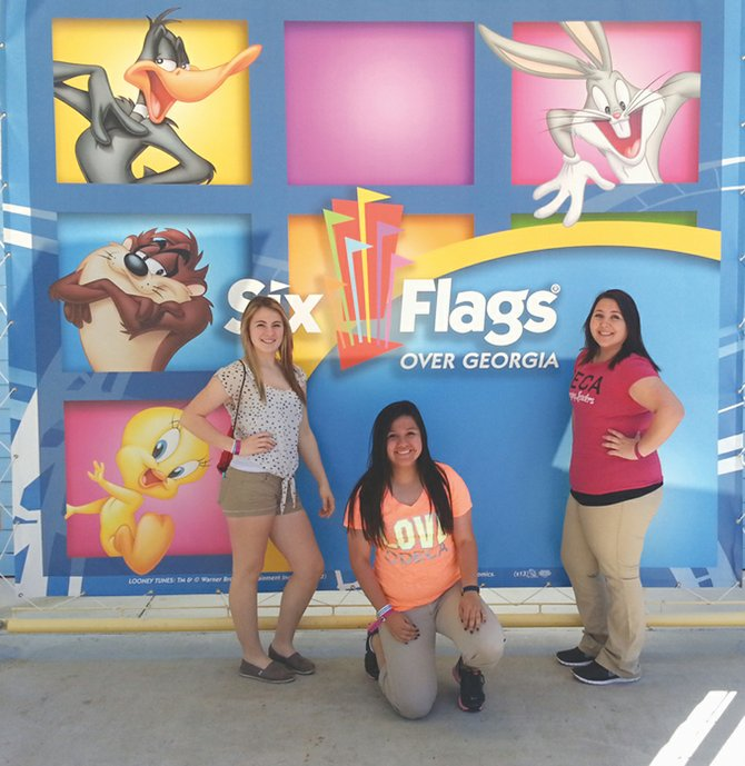 Miranda Ebbelaar, Alondra Perez and Alicia Galvan (L-R) are ready for some fun at Six Flags Over Georgia theme park during their adventures at the International Career Development Conference in Atlanta.