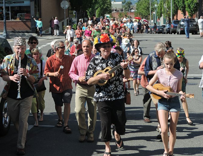 Ben Bonham, center, leads a New Orleans-style celebration on Saturday afternoon through Hood River.