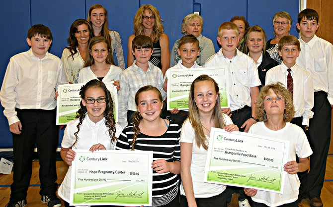CenturyLink recently made several grants to Grangeville non-profits. Some of the students who worked on choosing the grants and the recipients are pictured here.