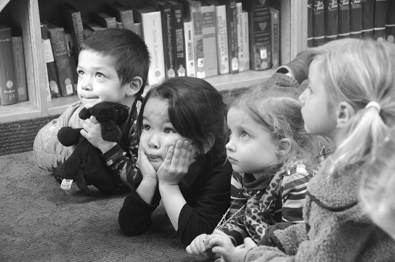 A variety of programs are set for this summer at Grangeville Centennial Library. Here, kids listen to a story at the library.