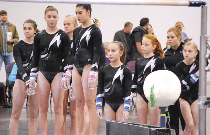 The Riverside Gymnastics' advanced team (pictured from left to right), McKenna Bailey, Cedar Willey, Kendyl Kumm, Audrey Hinatsu, Hannah Carrociolo, Emma Smith, Bailey Coyner and Elena Cardosi size up the competition at a meet earlier this year. (not pictured are Hannah Hinshaw and Taylor Sugg). A rigorous schedule spanning several states brought many personal records this spring season.