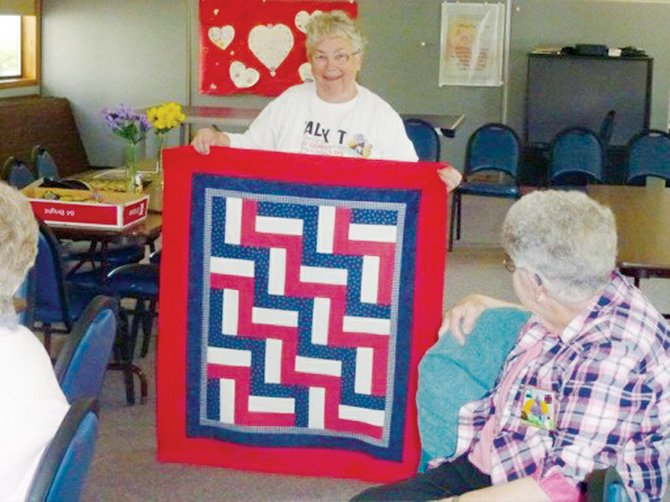 Each month area quilters share their favorite sewing projects with Horizon Quilters Unlimited of Yakima Valley. Here, Susie Myers of Outlook displays a quilt she made for the Wounded Warriors Program as Irene Luther of Grandview looks on at the quilt. The Tuesday, June 10, program will be provided by Jo Mathias of the Tri-Cities Quilters Guild, who will be demonstrating ice dying of fabric. The group meets at Grandview's Immanuel Lutheran Church Hall, 300 S. Euclid Rd. A social hour will start at 9 a.m., with the meeting at 9:30 a.m. A potluck lunch will follow.
