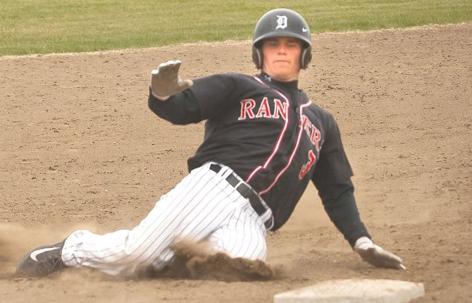 DUFUR senior Cole Parke slides in safely on a stolen base attempt in a league matchup this season in Moro. Parke batted .578 with a team-high eight home runs and 50 RBIs in 29 games played this year. On the mound, Parke went 7-4 and struck out 51 batters in 50 innings pitched.