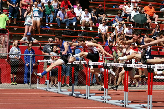 Columbia High senior Nathan Bell (second from left) pursues Rochester's Cody Triana last Saturday for the title of 1A boys 110-meter hurdles champion. Bell matched his 2013 performance with a third-place finish. Later in the day, Bell was part of a 300 hurdles final in which the top-four finishers broke 40 seconds. Bell lowered his school record in the event for the second time in eight days, coming in fourth in a time of 39.82 seconds. He ran 40 flat at the district meet on May 23.