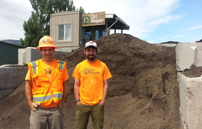 Dirt Hugger owners Tyler Miller, left, and Pierce Louis, backed here by a mountain of the company's compost, are making plans to locate their business to a more permanent facility on land in the Dallesport Industrial Park.
