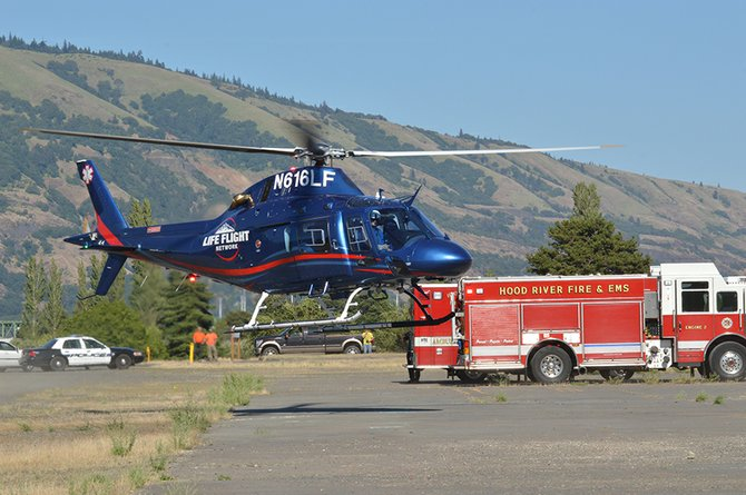 "A Life-Flight helicopter lifts off from Lot 1 on Port of Hood River property, carrying David Carter to a Portland hospital after he was burned Wednesday afternoon by hot water in an industrial accident at Ryan's Juice, where he works as a production manager. Bob Francis, chief operations officer of the juice company, said Carter received burns to 25 percent of his body, but that the prognosis for his recovery is ""very good."""
