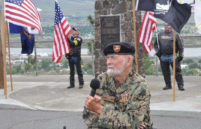 DAN BROPHY, a former Marine and The Dalles outpost leader for Pointman Ministries, is shown speaking at an earlier Memorial Day observance. He said faith in God can help veterans overcome obstacles and use their military training to become leaders in the community.	Chronicle file photo