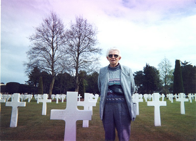 Tommy Elliott of Parkdale visits her brother Wilbur's grave in Normandy in 1990.