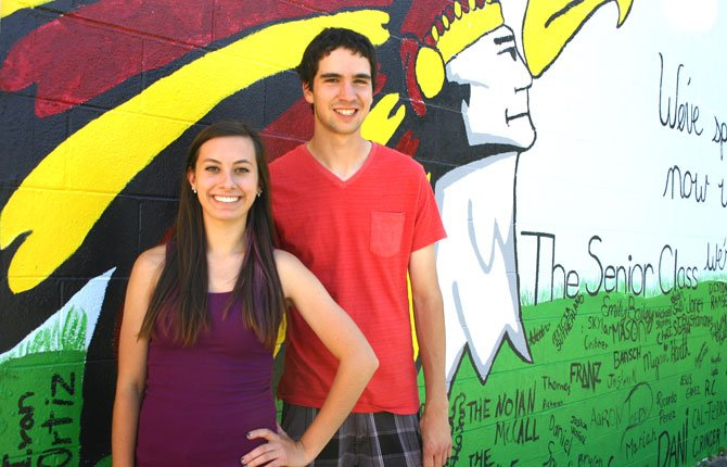 THE DALLES HIGH School class of 2014 Salutatorian Carsen Cordell (left) and Valedictorian Cole McDowell (right) pose for a photo beside their senior class mural during graduation practice on Amaton field June 5.