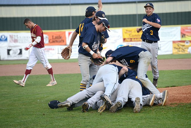 The Hood River Valley Eagles dogpile Ryan Ward Tuesday in the team's commanding win at Crescent Valley High.
