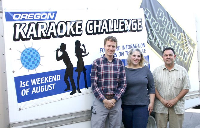 MATTHEW KLEBES, The Dalles Main Street coordinator, poses with Dia Nickelsen and Eloy Pando of the Oregon Karaoke Challenge.