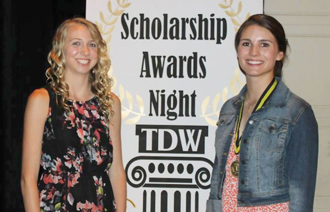 THE DALLES senior athletes Erin Nelson (left) and Emily Bailey are all smiles after winning major awards at the school's year-end All-Sports Awards Show at the Civic Auditorium in The Dalles.                              Contributed photo