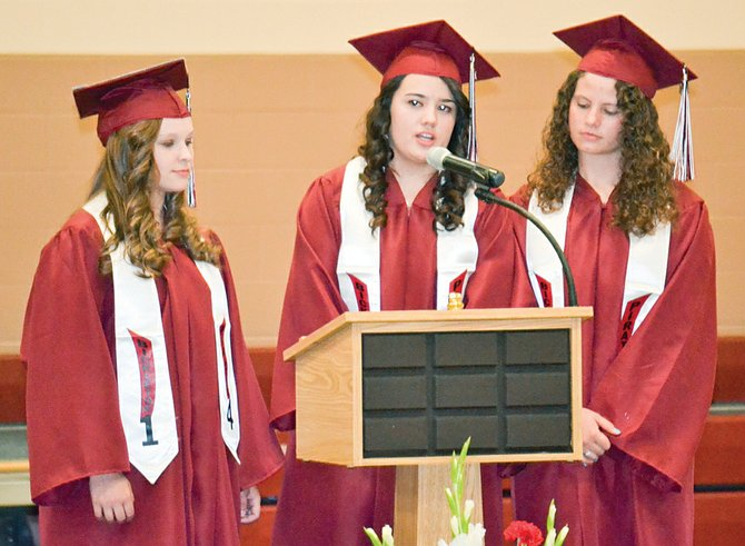 Bickleton High School's class of 2014 recites a poem during commencement exercises. Pictured from left are Annie Lindsley, Kayli Berk and Sydnie Whitemore.