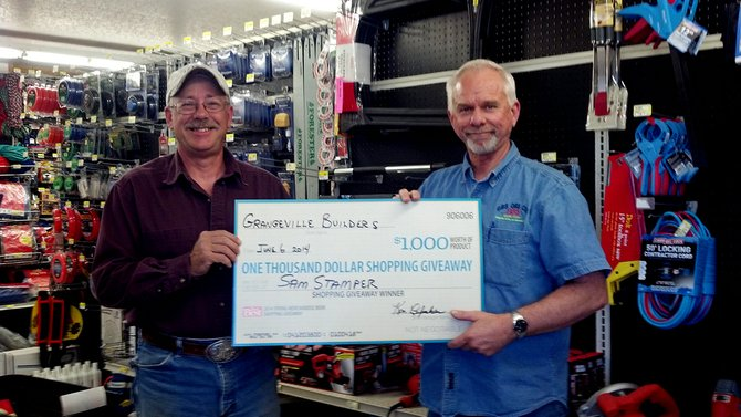 The $1,000 shopping spree sweepstakes winner for Grangeville Builders Supply is (left) Samuel Stamper, Jr., of Grangeville.