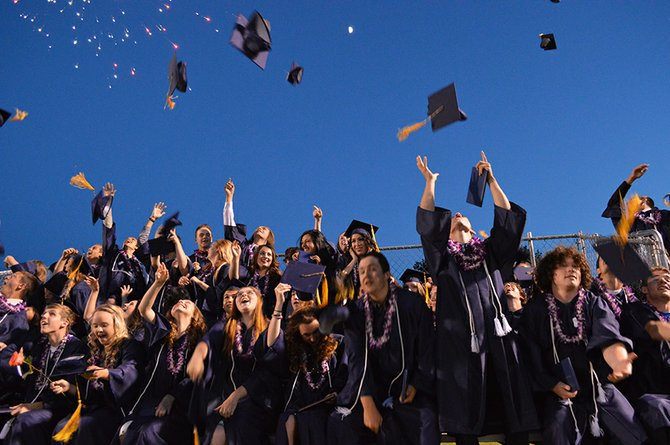 HRVHS Class of 2014 jubilantly tosses their mortarboards at the conclusion of Friday's graduation ceremony.