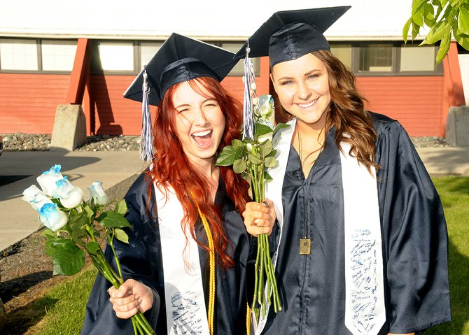 (L-R) Emily Sherwood and Delanie Adams were all smiles at Grangeville High School graduation, June 7.