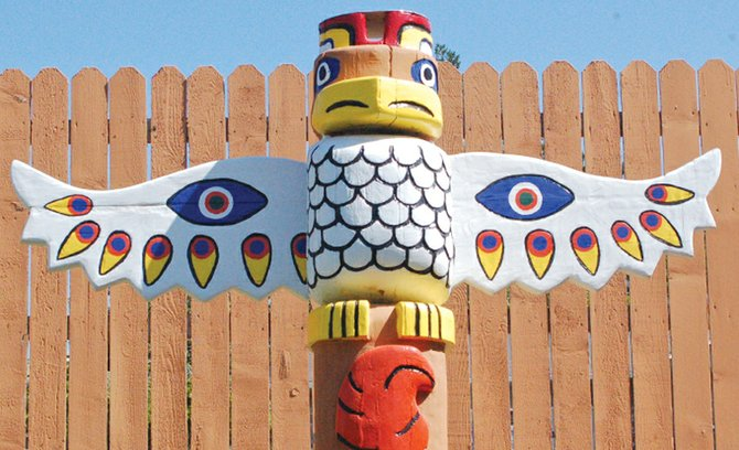 Adding to the color of Berks's back yard is this 12-foot tall totem pole created for him by his late daughter, Susan Householder. Every few years Berk touches up the paint on the totem, keeping the colors as crisp as the day he received it.