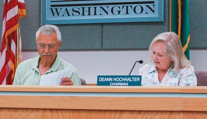 Planning Commission members Leroy Werkhoven (left) and Deann Hochhalter discuss the possibility of allowing chickens to be raised within Sunnyside city limits at Tuesday night's commission meeting.