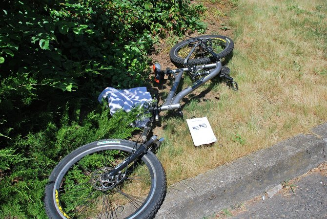A mountain bike ridden by Miguel Elizondo-Villa, 22, of White Salmon, languished next to Snohomish Avenue Friday morning. Elizondo-Villa was riding the bike down Snohomish Avenue Thursday night when he slammed into a parked car. Police reports state that once paramedics arrived Elizondo-Villa became combative, prompting the responding officer to use a stun gun to subdue him.