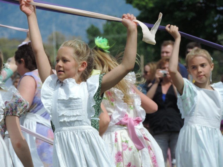 May Pole dancers concentrate on winding ribbons during the 80th annual Oroville May Festival. The May Pole Dance has been a festival fixture from the beginning.