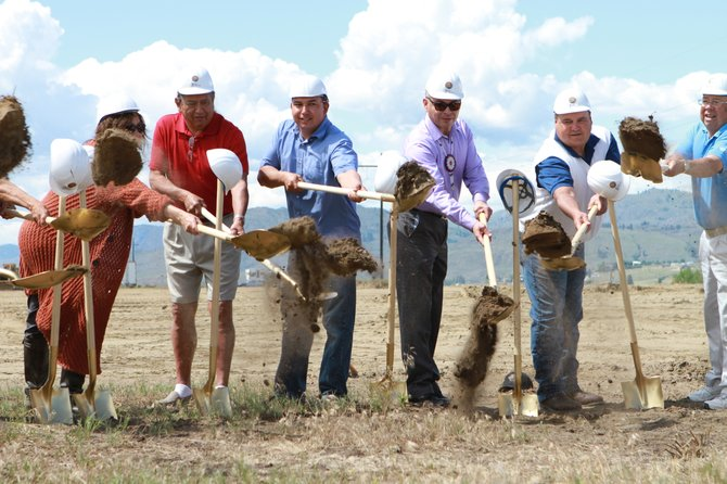 "Colville Tribal Federal Corp. board member Ken ""Butch"" Stanger, far left, and Colville Business Council members Ricky Gabriel, John Sirois and Richard Tonasket, break ground Monday at the new casino site off U.S. Highway 97 in Okanogan."