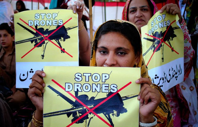 Pakistani women take part in a rally against the U.S. drone strikes in Pakistani tribal areas in Peshawar, Pakistan on April 23, 2011. The secret targeted killing program that once was the mainstay of President Barack Obama's counterterrorism effort appears to be winding down.