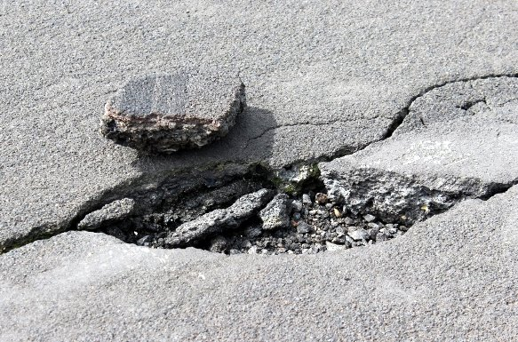 A chunk of loose asphalt, one of the problems to be addressed in the three-day repair at the east end of the Idaho County Airport's runway.