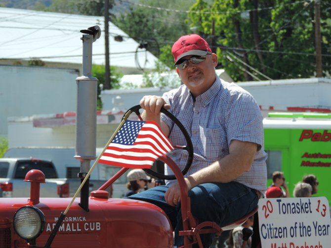 Tonasket Citizen of the Year Matt Deebach cruises the streets on a vintage International Harvester Cub tractor.