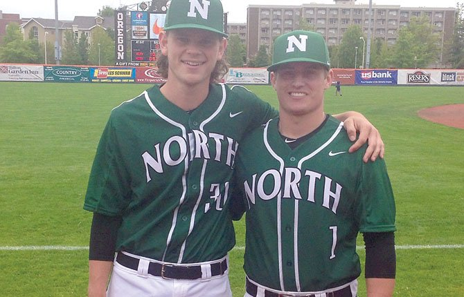 THE DALLES High School graduates, Clay Copper (left) and Nolan McCall pose for a photo at Saturday's Reser's Oregon State-Metro 6A/5A All-Star Series games at Goss Stadium in Corvallis.