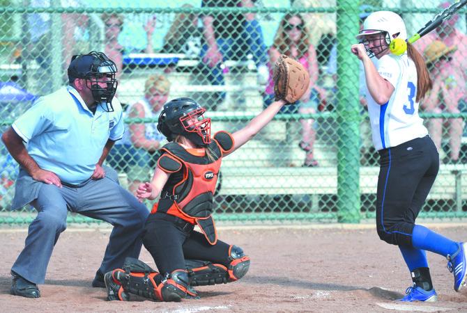 La Conner's Lauren Reynolds is struck by a pitch Friday. Bridgeport's catcher is Mari Hourie and the umpire is Aaron Rebhahn.