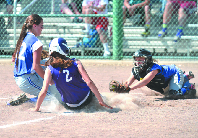 Haleigh Gibson of Curlew, right, dives to tag Lauren Gelstin of Pateros during state 1B softball Friday.