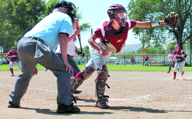 Okanogan catcher Kylie Stewart grabs the ball at home during game against Hoquiam on Friday.
