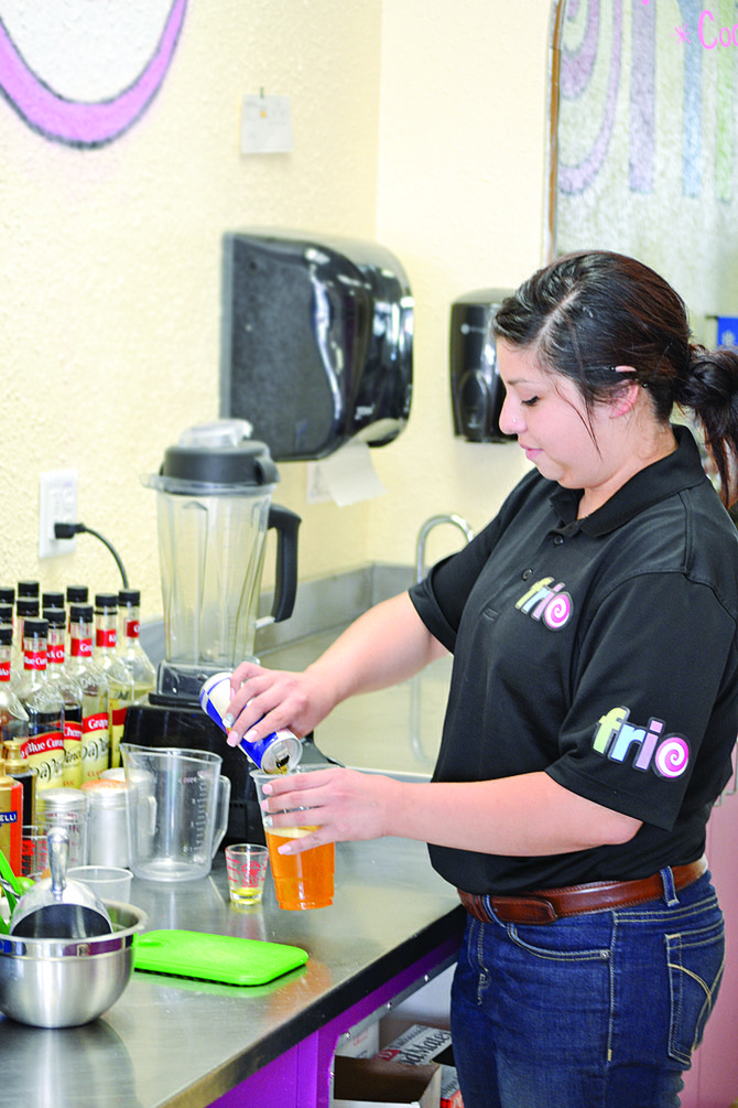 Samantha Lopez mixes a Red Bull Twister for a customer, one of several popular beverages at Frio in downtown Sunnyside.